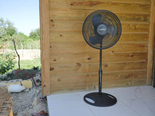 "Lasko 18"" Pedestal Fan on a Porch"